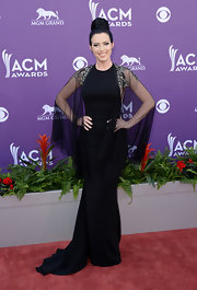 Shawna Thompson chose a classic black gown with cool sheer sleeves and beaded shoulders for her Gothic-inspired red carpet look.