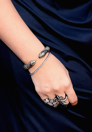 Hillary Scott added a touch of bling to her red carpet look with this cool snake bracelet.