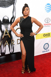 Taraji P. Henson worked an edgy-sexy vibe at the NAACP Image Awards in a black Alexander Wang leather-panel gown with a hip-grazing slit.