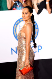 Tracee Ellis Ross amped up the shine with this gold Tyler Ellis clutch and sequin dress combo at the 2018 NAACP Image Awards.