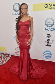 Serayah McNeill looked pageant-ready in a red mermaid gown with lace inserts at the NAACP Image Awards.