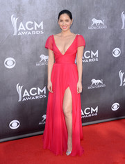 Olivia Munn showed off plenty of cleavage and leg in a low-cut pink Reem Acra gown during the ACM Awards.