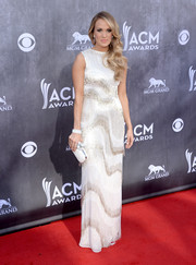 Carrie Underwood went for flapper glamour in a fringed, beaded white gown by Oscar de la Renta during the ACM Awards.