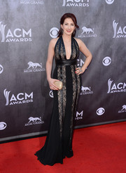 Katie Armiger oozed sex appeal in a cleavage-baring black lace halter gown during the ACM Awards.