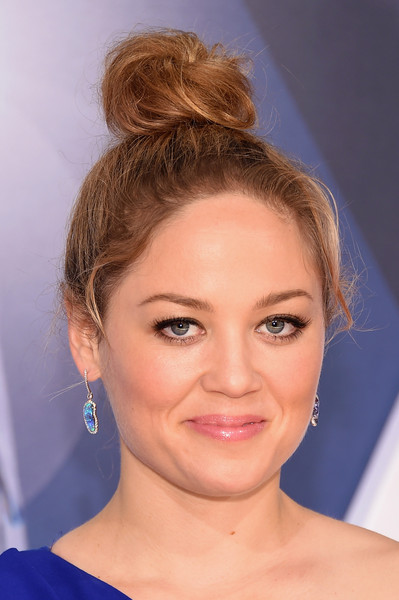 Erika Christensen pulled her hair up into a messy top knot for her CMA Awards look.