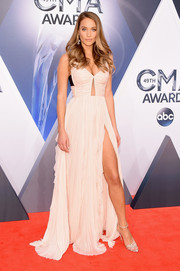 Hannah Davis flashed plenty of skin in a cleavage-flaunting, high-slit cutout gown by J. Mendel at the CMA Awards.
