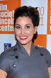 Gina Gershon wore rich red lipstick for a feminine finish to her look during the 'My Week with Marilyn' presentation.