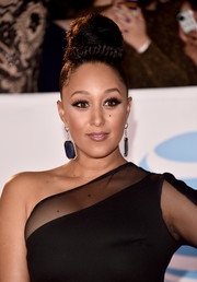 Tamera Mowry-Housley attended the 2018 NAACP Image Awards wearing a huge bun with a wraparound braid.