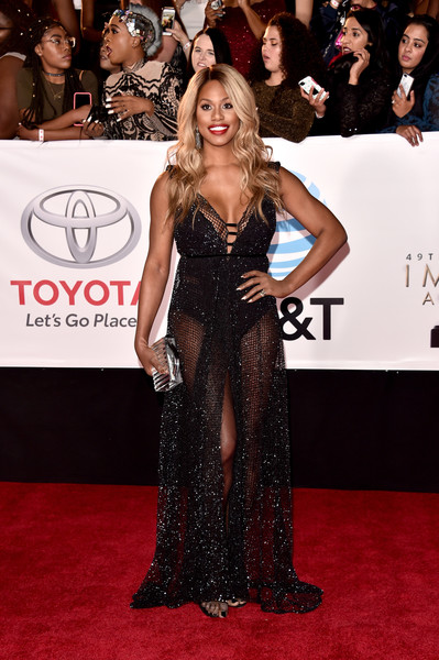 Laverne Cox styled her look with a clear box clutch by L'Afshar.