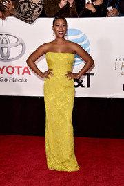 Samira Wiley brightened up the red carpet with this strapless yellow column dress by Romona Keveza at the 2018 NAACP Image Awards.