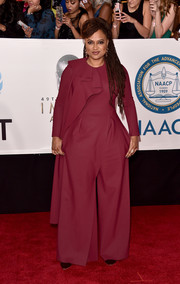 Ava DuVernay chose a loose burgundy Greta Constantine jumpsuit with ruffle detailing for the 2018 NAACP Image Awards.