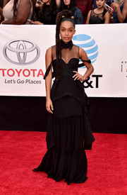 Yara Shahidi was goth-chic in a black Vera Wang corset gown with a sheer yoke and a tiered skirt at the 2018 NAACP Image Awards.