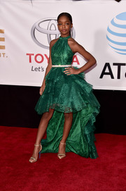 Marsai Martin was a gem in this shimmering green fishtail dress by Pantora Mini at the 2018 NAACP Image Awards.