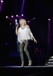 Carrie Underwood rocked shredded ripped jeans while belting it out on stage at the 4th ACM Party for a Cause Festival.