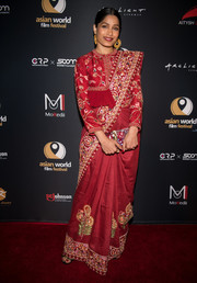 Freida Pinto embraced her roots with this hand-embroidered red saree by Rahul Mishra at the Asian World Film Festival.