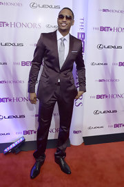 Trey Songz showed off his sleek side in a brown suit at the BET Honors Awards. He completed his look with a gray button down.