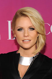 Carrie Keagan chose a modern and sleek look with this pinned back 'do that almost resembles a faux bob.