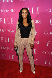 June Ambrose was spotted at the 4th Annual Elle Women in Music Celebration wearing a print pantsuit.