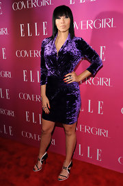 Bridget Kelly chose a vibrant purple velvet frock with a gathered waist.