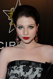 Michelle Trachtenberg channeled old Hollywood glamour at the Gollywood Domino Gala in flaming red lipstick.