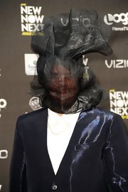Perez Hilton wrapped himself up like a gift with this gauzy black headdress during the 2011 NewNowNext Awards.