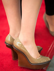 Ginnifer Goodwin sported nude wedges with a curved heel for her red carpet look.