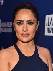 Salma Hayek chose a simple ponytail for the 4th Annual Sean Penn & Friends 'Help Haiti Home' Gala Benefit, showing off the fabulous racer-front neckline of her gown.