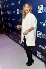 Rebecca Dane arrived at the 4th Annual Sean Penn & Friends HELP HAITI HOME Gala wearing a gorgeous over-sized white coat.