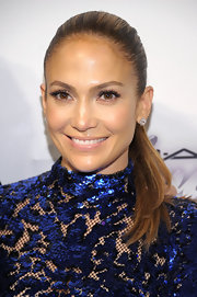 Jennifer Lopez stuck to a sleek and straight ponytail at the amfAR Inspiration Gala New York.