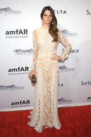 Jeisa Chiminazzo kept her look ethereal and romantic with a nude and white embroidered dress.