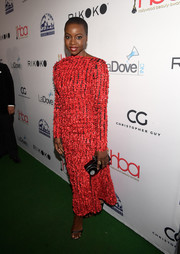 Danai Gurira paired her dress with a black and silver box clutch.