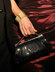 Ramona Singer held a sequined evening purse at a 50 & Fabulous event.