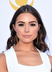 Olivia Culpo wore her hair with a center part and pretty waves during the Academy of Country Music Awards.