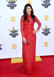 Karen Fairchild cut a regal figure in a red lace column dress by Valentino at the Academy of Country Music Awards.