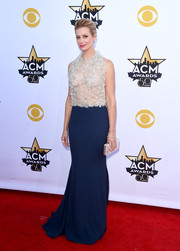 Beth Behrs chose a metallic silver clutch to complete her red carpet look.