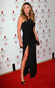 Daisy Fuentes showed off her tan legs in a black evening dress with a hip-high slit.