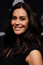 Megan Gale left her hair loose in billowy waves when she attended the Wool Awards.