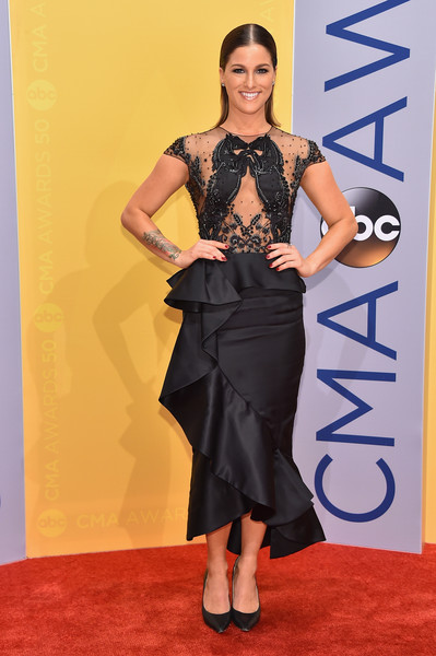 Cassadee Pope opted for a little black dress, featuring a ruffle skirt and a pair of strategically placed horses on the sheer bodice, when she attended the CMA Awards.