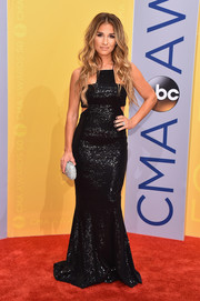 Jessie James Decker added more sparkle with a crystal clutch.