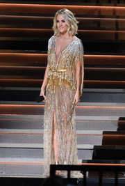 Carrie Underwood looked absolutely radiant in an ombre beaded gown by Labourjoisie at the CMA Awards.