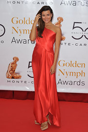 "Cote looked like a Greek goddess at the ""Golden Nymph Awards,"" in a floor length coral gown."