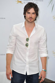 We're not sure how Ian manages to make a white button-up look dangerous.