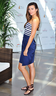 Cote kept her look carefree and chic in a strappy pair of brown sandals. The casual footwear paired well with the nautical vibe of her dress.