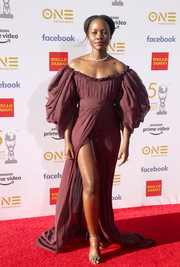 Lupita Nyong'o looked regal in a plum Giambattista Valli Couture gown with voluminous sleeves and an off-the-shoulder neckline at the 2019 NAACP Image Awards.