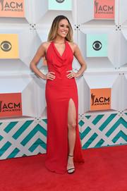 Jana Kramer chose a pair of black slim-strap sandals to complete her look.