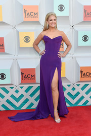 Nancy O'Dell looked flawless in a strapless purple gown by Mark Zunino Couture at the Academy of Country Music Awards.
