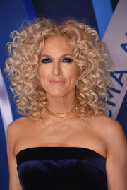 Kimberly Schlapman rocker her signature high-volume curls at the 2017 CMA Awards.