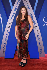 Hillary Scott kept it breezy on the red carpet in this floral slip dress at the 2017 CMA Awards.
