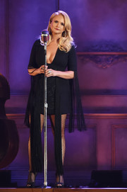 Miranda Lambert performed at the 2017 CMA Awards wearing a fringed LBD with a plunging neckline.