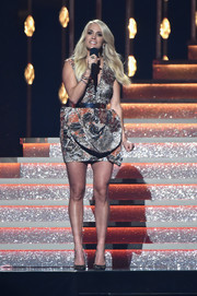 Carrie Underwood spoke onstage at the 2017 CMA Awards wearing a metallic mini dress with a sculptural skirt.